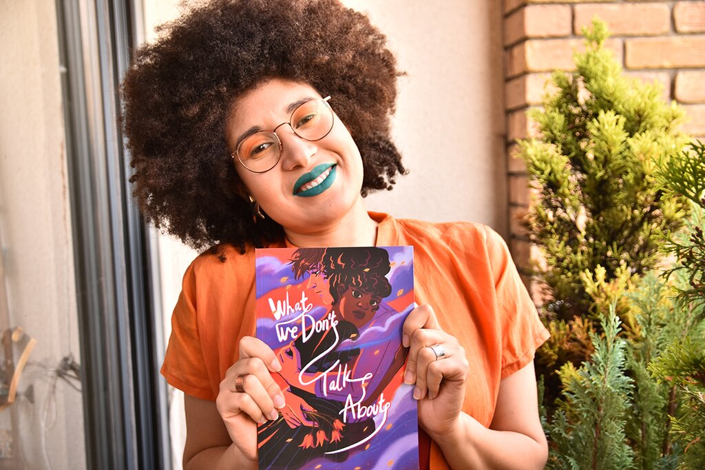 Charlot Kristensen with her comic What We Don't Talk About